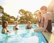 Older Caucasian women talking in swimming pool