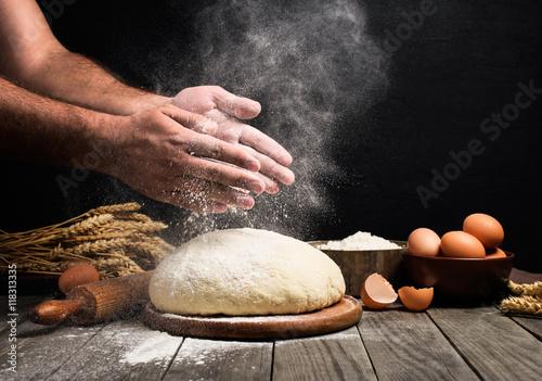 Fotografie, Obraz  Man Making bread