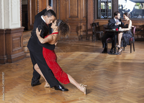 Photo  Tango Dancers Performing While Mid Adult Couple Dating