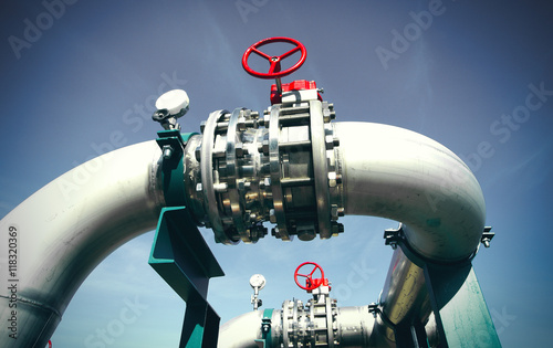 Photo  Industrial zone, Steel pipelines and valves against blue sky