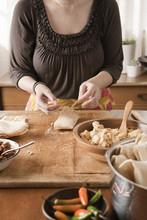 Woman Making Tamales