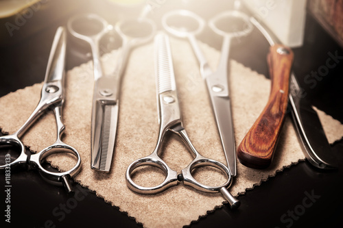 Photo  Straight razor and different scissors