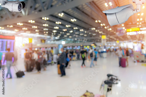 Foto auf AluDibond Bahnhof Closeup CCTV security camera on blurred inside the airport terminal background.