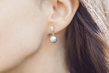 Woman Ear Wearing Beautiful Lu...