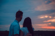 Love story. In love couple walking on sunset background. Happy end. Silhouette figures of people in love on the nature. Screensaver for the film.