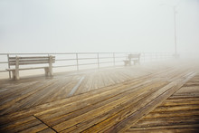Fog Over Benches On Wooden Boa...