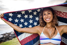 Woman Standing Under American Flag Quilt