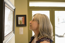 Caucasian Woman Admiring Paint...