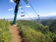 Mountain Biking Trail Going Under A Ski Lift In Park City, Utah