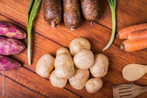 Fotografie, Obraz  Vegetables over wooden table