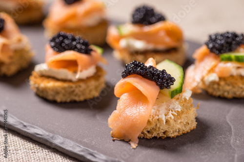 Recess Fitting Appetizer Smoked Salmon Canapes with Sour Cream and Caviar