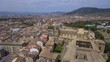 Flying above Old Town buildings and Cathedral in Pamplona, Spain