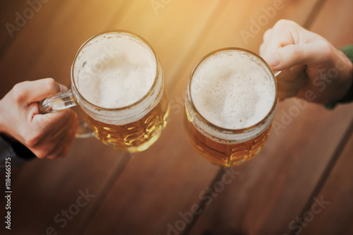 Canvas Prints Beer / Cider close up of hands with beer mugs at bar or pub