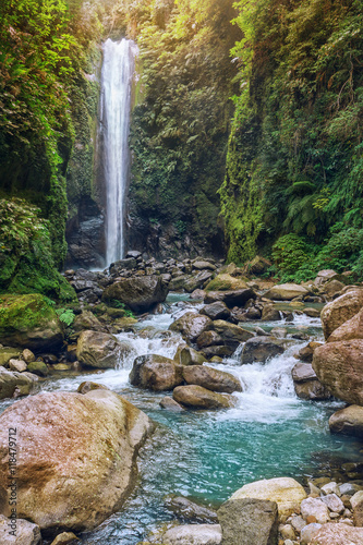 Waterfall and mountain river in tropical forest © srady