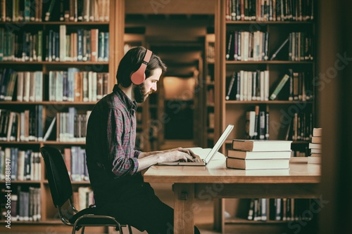 Hipster student studying in library Fototapeta
