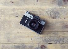 Vintage Photo Camera On A Wood...