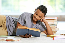 Cute Boy Reading Book At Home