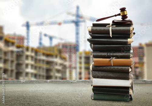 Gavel on buildings and cranes background Canvas Print