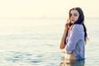 Woman in shirt get wet in the sea
