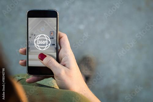 Fotografija Woman surfing a 360 degree view in her smartphone