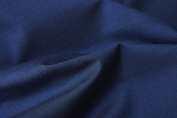 Fototapeta na wymiar A full page close up of royal blue suit fabric texture