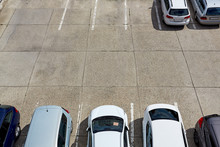 Half Empty Outdoor Parking Lot With Cars. City Car Park On Concrete Surface.