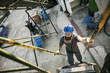 Worker climbing stairs outdoors