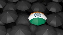 India Flag Umbrella Over Black Umbrellas. 3d Illustration