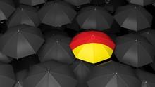 German Flag On Umbrella Over Black Umbrellas