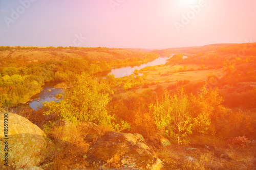 Keuken foto achterwand Rood traf. Rural autumn sunrise landscape with river and colorful trees, seasonal background with sun light