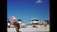 1959: Boy Running Away Beach Classic 1950s Cars Perfect Blue Sky Day.