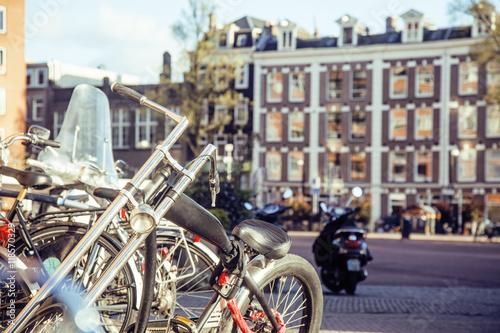 Deurstickers Fiets post card view: bike parking on european city street, Amsterdam