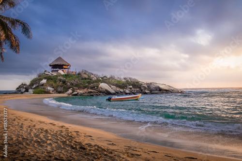 Fotografie, Obraz  Sunrise and beach hut at Cabo San Juan - Tayrona Natural National Park, Colombia