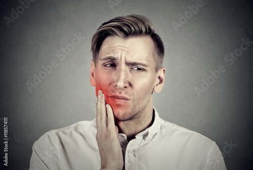Fotografia  Man with sensitive toothache problem about to cry from pain