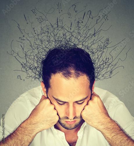 Fototapeta sad man with stressed face expression brain melting into lines obraz na płótnie