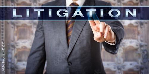 Photo  Male Attorney Pressing LITIGATION Onscreen