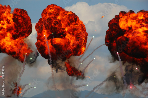 фотография  Explosions as part of a demonstration at an air show