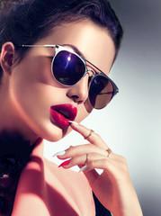 Sexy model girl wearing stylish sunglasses