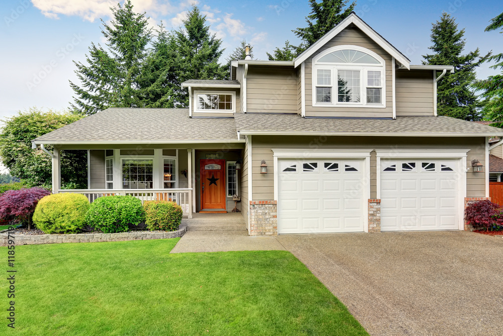 Fototapety, obrazy: American house exterior with double garage and well kept lawn.