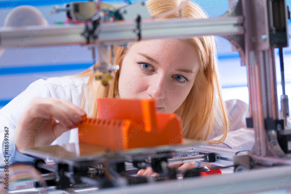 Fototapety, obrazy: Young woman work with 3d printer