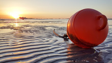 Red Buoy On The Rimini Riccione Beach At Sunset