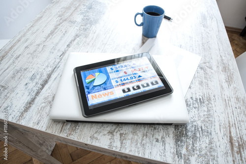 Fotografía  Stock market trading app on a Tablet PC