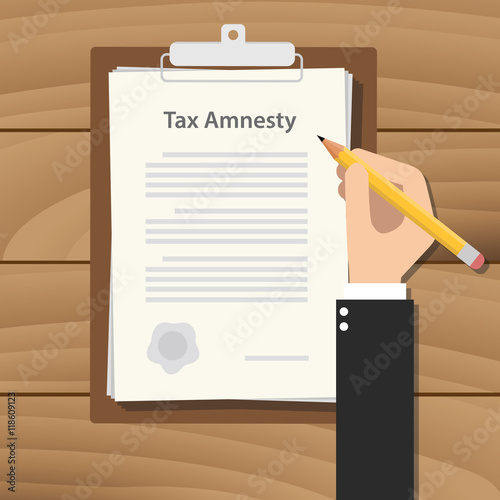Photo tax amnesty illustration with pople hand write on the paper document on top
