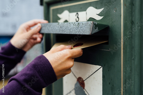 Posting letter to old postbox on street Canvas Print