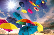 canvas print picture - Happiness, lust for life: flying colorful umbrellas on in front of blue sky :)