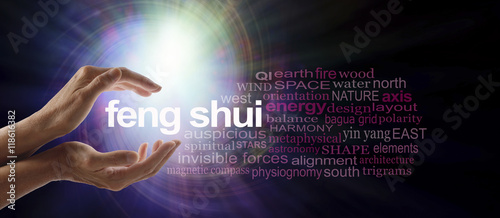 Fotografie, Obraz  Shedding light on Feng Shui - Female hands cupped around the words FENG SHUI sur