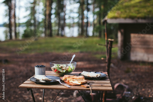 Keuken foto achterwand Picknick picnic in the woods. kebab, salad and berries
