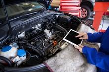 Mechanic Using A Digital Table...