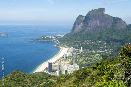 Scenic skyline view from above Sao Conrado Beach with Pedra da Gavea mountain and the favela community of Rocinha in Rio de Janeiro, Brazil