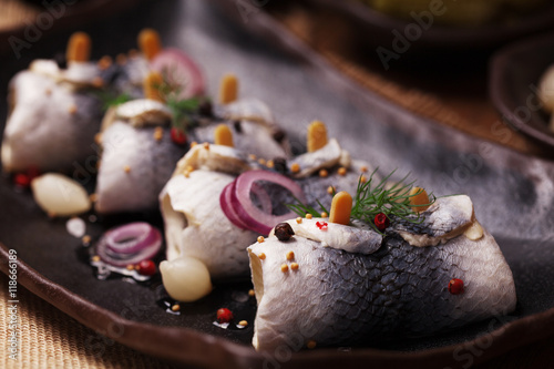 Rolled herring in vinegar, served with onions and pickles.
